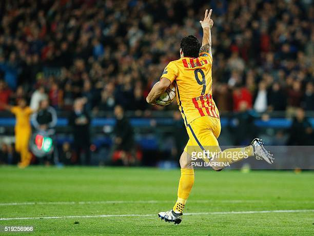 Barcelona's Uruguayan forward Luis Suarez runs with the ball after scoring during the UEFA Champions League quarter finals first leg football match...