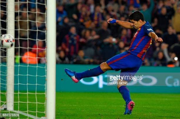 TOPSHOT Barcelona's Uruguayan forward Luis Suarez scores a cancelled goal during the Spanish Copa del Rey semi final second leg football match FC...