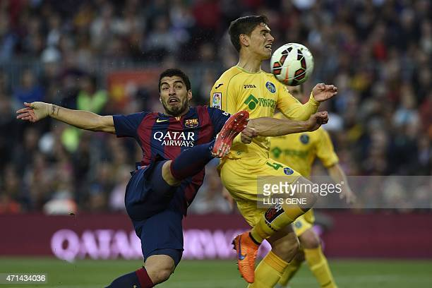 Barcelona's Uruguayan forward Luis Suarez scores a goal during the Spanish league football match FC Barcelona vs Getafe at the Camp Nou stadium in...