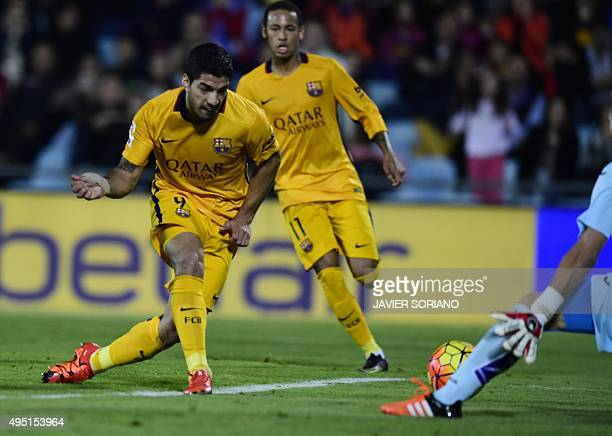 Barcelona's Uruguayan forward Luis Suarez scores during the Spanish league football match Getafe CF vs FC Barcelona at the Coliseum Alfonso Perez...