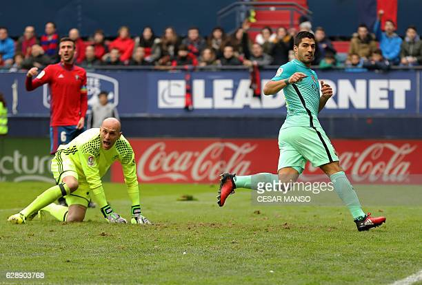 Barcelona's Uruguayan forward Luis Suarez scores during the Spanish league football match CA Osasuna vs FC Barcelona at the Reyno de Navarra stadium...