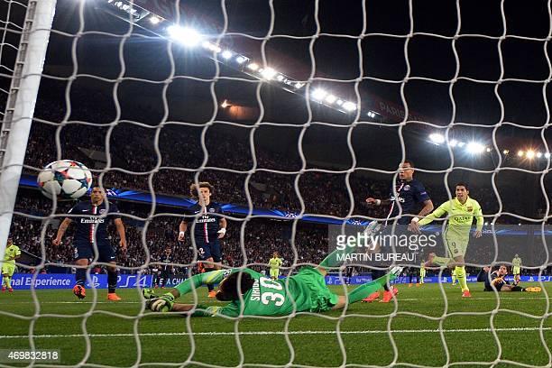 Barcelona's Uruguayan forward Luis Suarez scores his first goal past Paris SaintGermain's Italian goalkeeper Salvatore Sirigu during the UEFA...