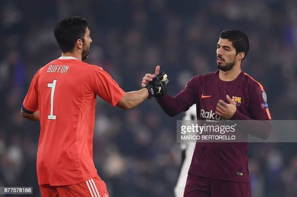 Barcelona's Uruguayan forward Luis Suarez shakes hands with Juventus' goalkeeper from Italy Gianluigi Buffon at the end of the UEFA Champions League...