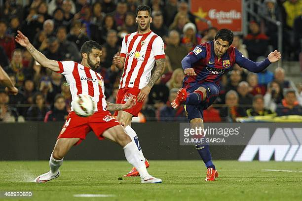 Barcelona's Uruguayan forward Luis Suarez shoots to score a goal during the Spanish league football match FC Barcelona v UD Almeria at the Camp Nou...