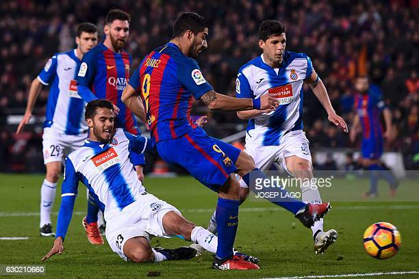 Barcelona's Uruguayan forward Luis Suarez shoots to score a goal during the Spanish league football match FC Barcelona vs RCD Espanyol at the Camp...