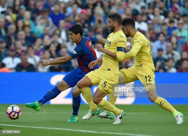 Barcelona's Uruguayan forward Luis Suarez shoots to score a goal during the Spanish league football match FC Barcelona vs Villarreal CF at the Camp...