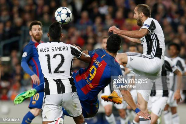 Barcelona's Uruguayan forward Luis Suarez tries to kick the ball beside Juventus' Brazilian defender Alex Sandro and Juventus' defender Giorgio...