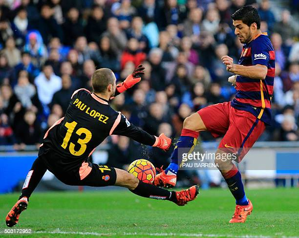 Barcelona's Uruguayan forward Luis Suarez tries to score past RCD Espanyol's Spanish goalkeeper Pau Lopez during the Spanish league football match...