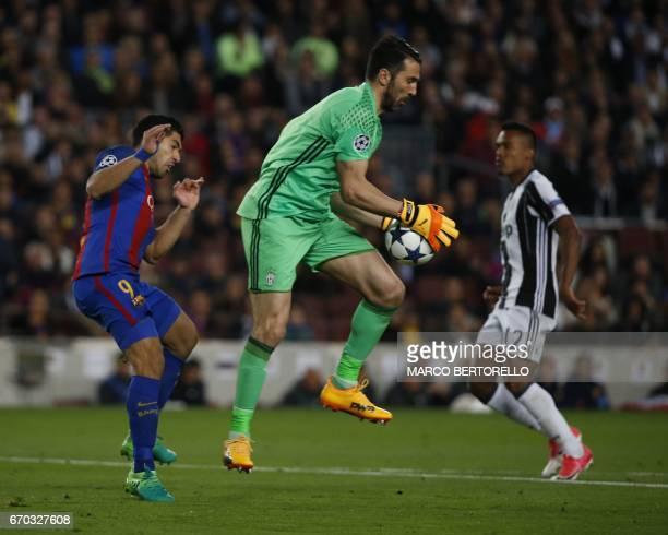 Barcelona's Uruguayan forward Luis Suarez vies with Juventus' goalkeeper Gianluigi Buffon during the UEFA Champions League quarterfinal second leg...