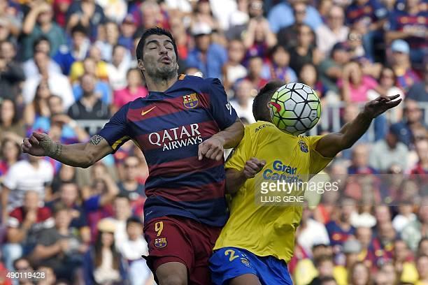 Barcelona's Uruguayan forward Luis Suarez vies with Las Palmas' defender Daniel Castellano Betancor during the Spanish league football match FC...