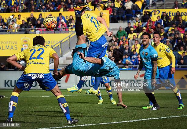 Barcelona's Uruguayan forward Luis Suarez vies with Las Palmas' defender Javier Garrido during the Spanish league football match UD Las Palmas vs FC...