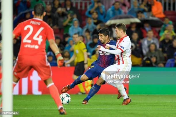Barcelona's Uruguayan forward Luis Suarez vies with Olympiacos' Spanish defender Alberto Botia during the UEFA Champions League group D football...