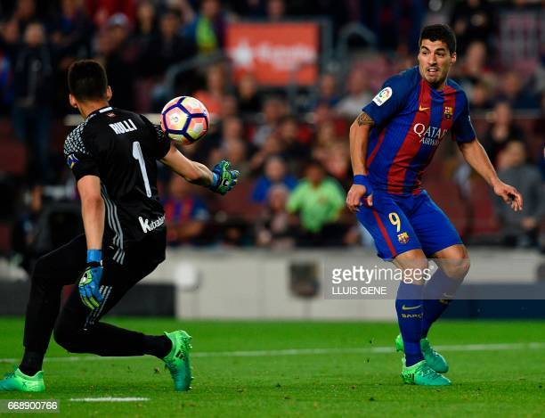 Barcelona's Uruguayan forward Luis Suarez vies with Real Sociedad's Argentinian goalkeeper Geronimo Rulli during the Spanish league football match FC...