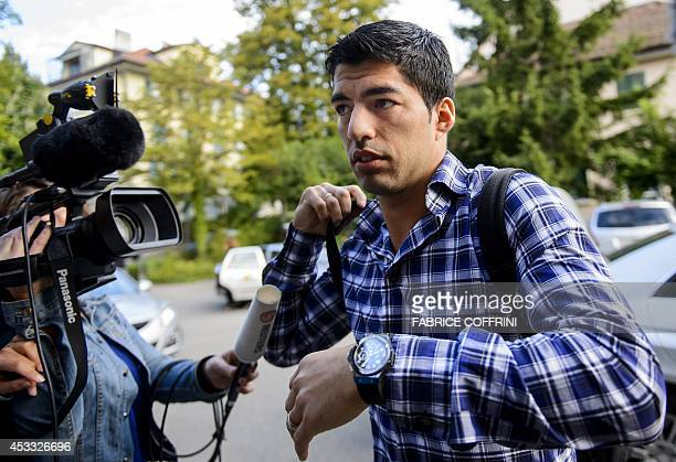 Barcelona's Uruguayan forward Luis Suarez who is currently serving a fourmonth suspension after his infamous World Cup bite of Italy's defender...