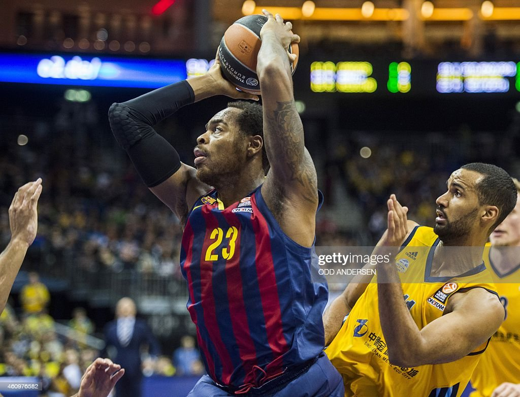 FC Barcelona's US forward Deshaun Thomas and Alba Berlin's guard Akeem Vargas vie for the ball during the Euroleague Top 16 Groupe E basketball match...
