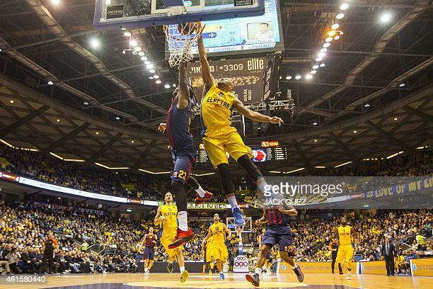 Barcelona's US forward Deshaun Thomas vies with Maccabi Electra's US guard Devin Smith during their Euroleague Top 16 basketball match between...