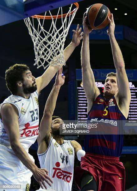 Barcelona's US forward Justin Doellman vies with Real Madrid's guard Sergio Llull and Real Madrid's Swedish forward Jeffery Taylor during the...