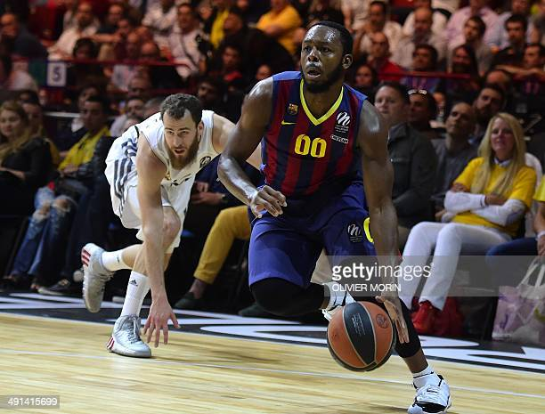 Barcelona's US guard Jacob Everse Pullen tries to score past Real Madrid's guard Sergio Rodriguez during their Euroleague 2014 semifinal Four...