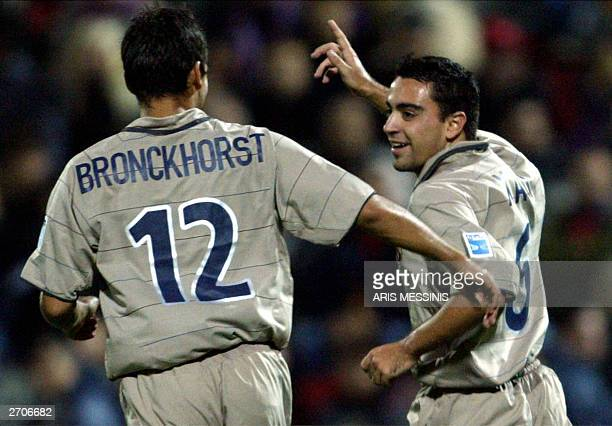 Barcelona's Xavi celebrates after scoring against Panionios during an UEFA cup soccer game in Athens 06 November 2003 AFP PHOTO/ Aris MESSINIS