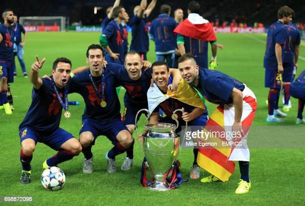 Barcelona's Xavi Hernandez Sergio Busquets Andres Iniesta Pedro and Jordi Alba celebrate with the trophy