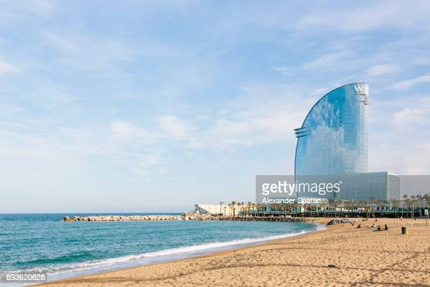 Barceloneta beach and W Hotel on a sunny day, Barcelona, Spain