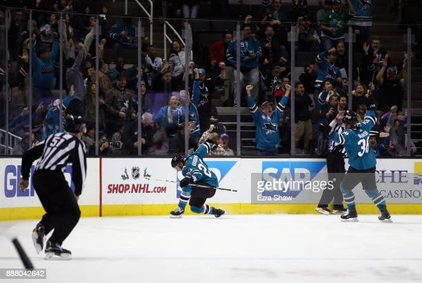 Barclay Goodrow of the San Jose Sharks and Jannik Hansen celebrate after Goodrow scored a shorthanded goal against the Carolina Hurricanes in the...