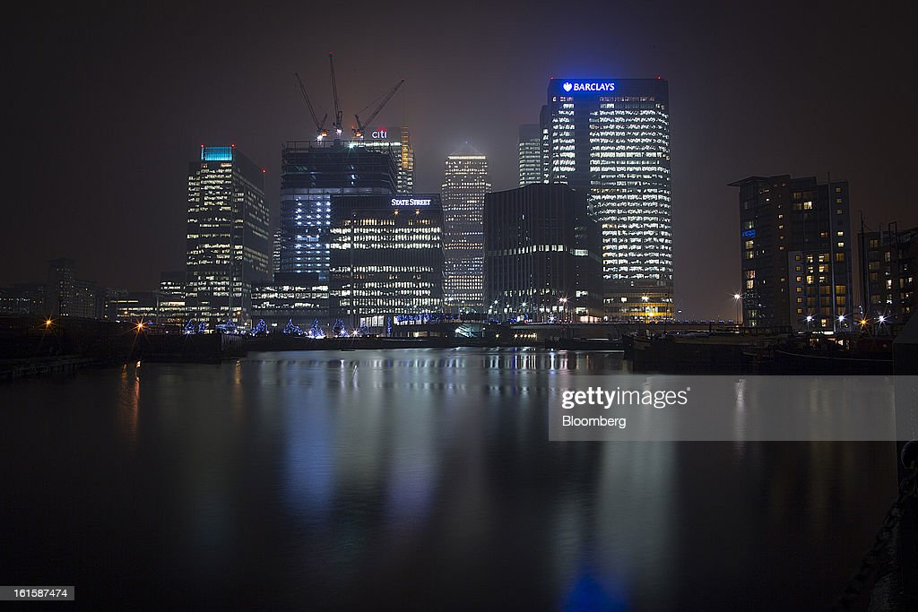 A Barclays Plc logo sits illuminated at night on the company's headquarters in the Canary Wharf business and financial district in London, U.K., on Monday, Feb. 11, 2013. U.K. inflation held at the highest rate since May last month and pipeline prices pressures increased as crude oil costs rose. Photographer: Jason Alden/Bloomberg via Getty Images