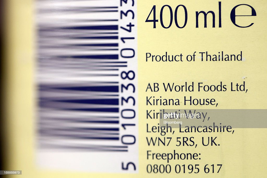 A barcode and correspondence address is seen on the label of a can of Blue Dragon sauce, produced by Associated British Foods Plc, inside a supermarket in London, U.K., on Monday, Nov. 5, 2012. AB Foods shares have gained 17 percent this year, fueled by the growth of the sugar unit and Primark, the company's two main profit contributors. Photographer: Simon Dawson/Bloomberg via Getty Images