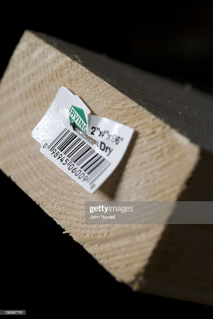 Barcode tag on wood : Stock Photo