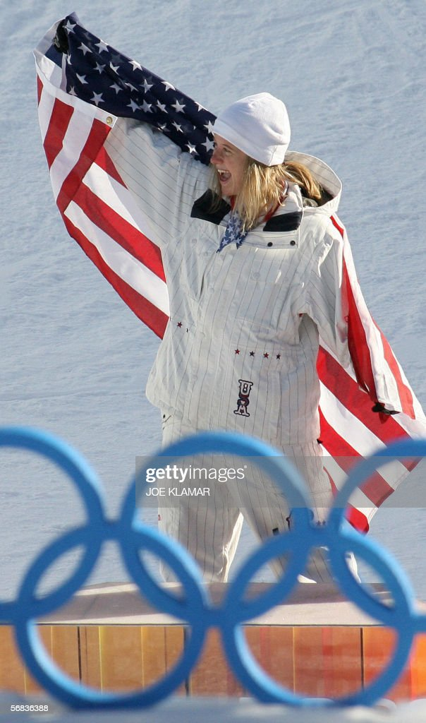 US Hannah Teter celebrates after winning the Ladies' snowboard Halfpipe final on the third day of the Turin 2006 Winter Olympics 13 February 2006 in...