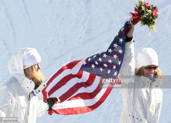 US Hannah Teter celebrates on the podium with fellow American Gretchen Bleiler after winning the Ladies' snowboard Halfpipe final on the third day of...