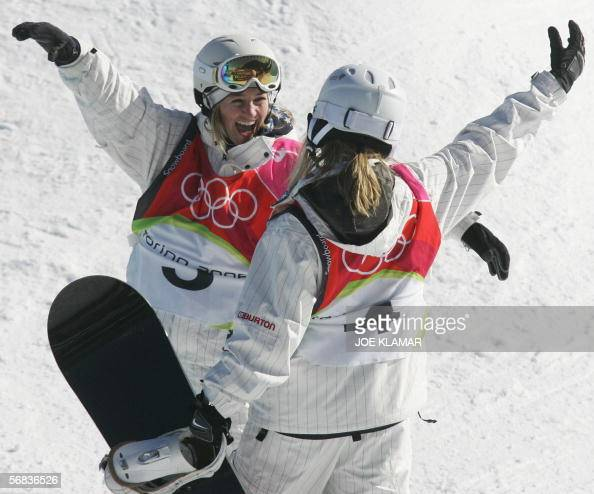 US Hannah Teter celebrates with fellow countrywoman Gretchen Bleiler after winning the Ladies' snowboard Halfpipe final on the third day of the Turin...