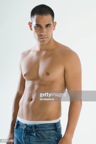 Bare chested Hispanic man