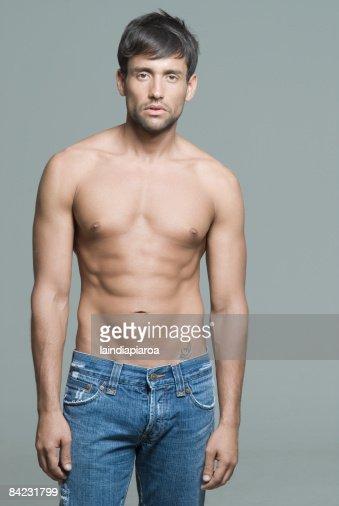 Bare chested Hispanic man : Stock Photo