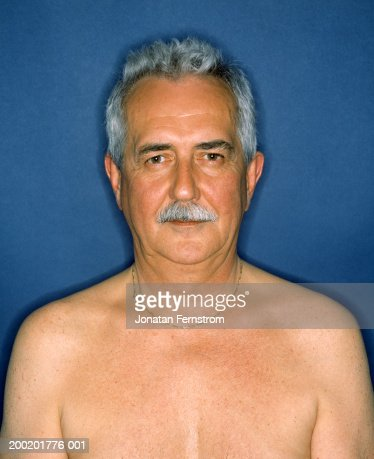 Bare chested mature man with moustache, wearing necklace, portrait : Stock Photo