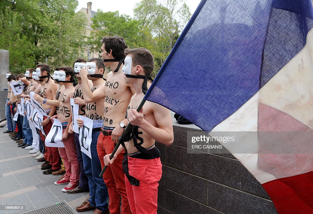 Bare chested men, members of the anti-gay marriage group Hommen, demonstrate in Toulouse on April 18, 2013. French Prime Minister Jean-Marc Ayrault called for calm on April 17, 2013 as the National Assembly prepared to give its final approval to a bill legalising same-sex marriage and adoption.