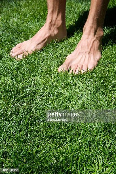 Bare Feet Standing in Green Grass
