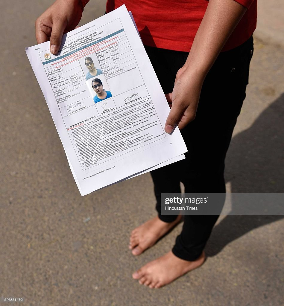 A bare foot student shows her ID card at the entrance before she was thoroughly scanned to take the All India Pre-Medical/Pre-Dental Entrance Test (AIPMT) at the examination centre at RK Puram on May 1, 2016 in New Delhi, India. The All Indian Pre-Medical Test (AIPMT) 2016, being treated as the first phase of the National Eligibility Entrance Test (NEET), was held on Sunday. The competitive examination held for entrance to MBBS and BDS courses across the country was held amidst tight security this year. Students had a proper dress code to adhere to as they were not allowed to enter the examination hall in shoes or carry any kind of stationary with them. Mobile phones were also not allowed
