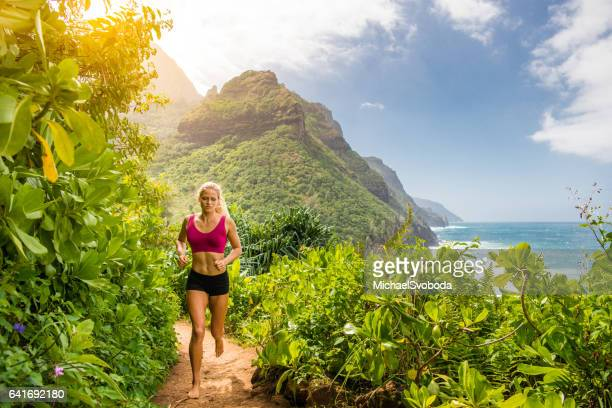 Bare Foot Trail Runner Along The Ocean