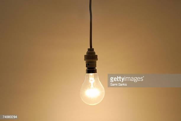 Bare hanging light bulb in studio