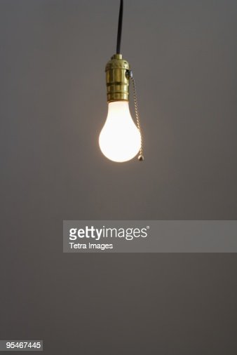 Bare Light Bulb Hanging From Ceiling Stock Photo