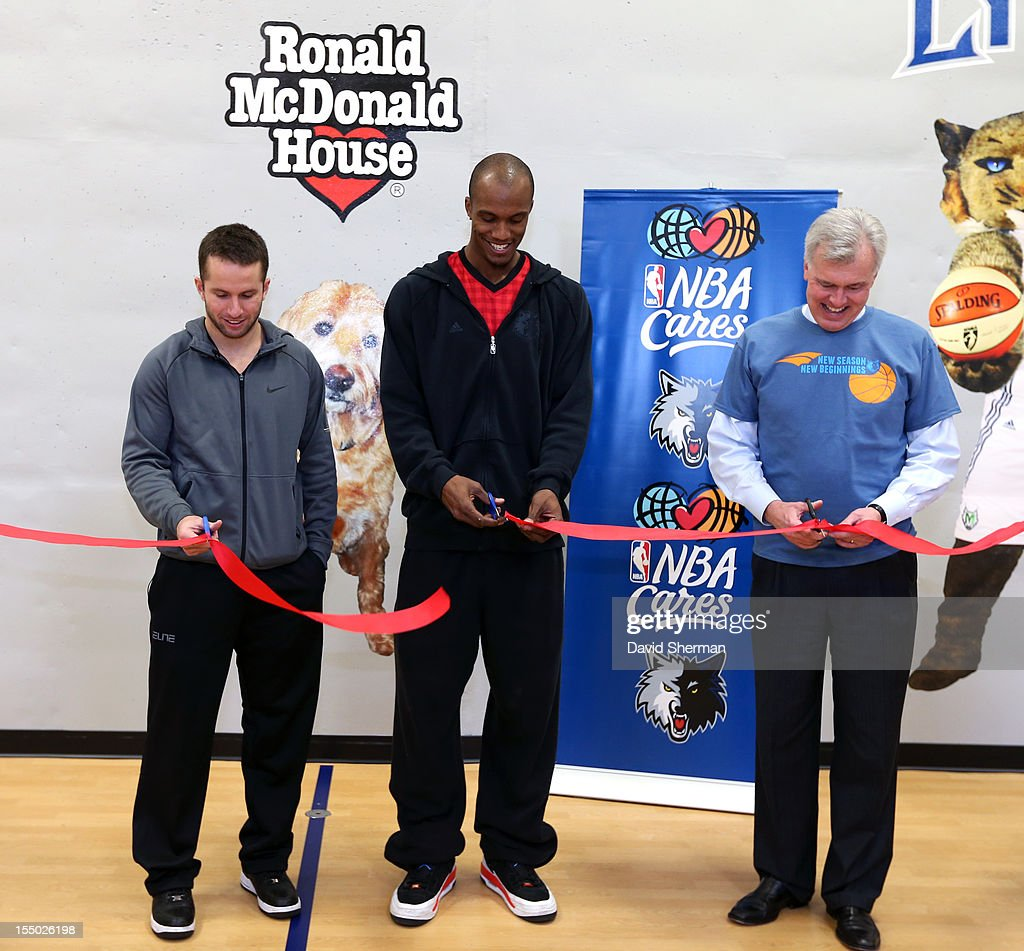 JJ Barea and Dante Cunningham of the Minnesota Timberwolves and John Stanoch, Presdient & CEO of Ronald McDonald House Charities Upper Midwest dedicate a refurbished basketball court on October 30, 2012 at the Ronald McDonald House - Oak Street in Minneapolis, Minnesota.
