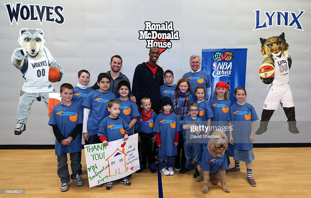 JJ Barea and Dante Cunningham of the Minnesota Timberwolves and John Stanoch, Presdient & CEO of Ronald McDonald House Charities Upper Midwest pose for a photograph with kids staying at the Ronald McDonald House after dedicating a refurbished basketball court on October 30, 2012 at the Ronald McDonald House - Oak Street in Minneapolis, Minnesota.