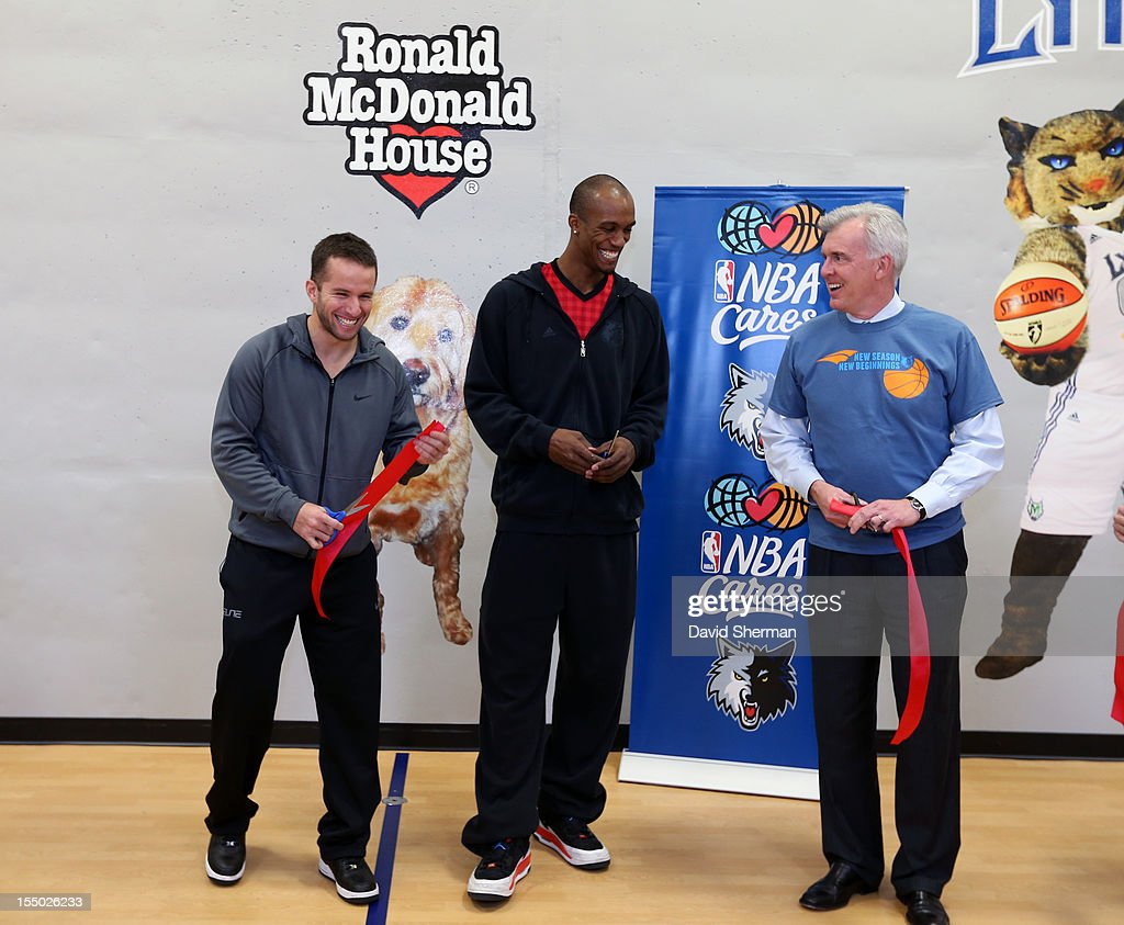 JJ Barea and Dante Cunningham of the Minnesota Timberwolves and John Stanoch, Presdient & CEO of Ronald McDonald House Charities Upper Midwest share a laugh after cutting the ribbon for a refurbished basketball court on October 30, 2012 at the Ronald McDonald House - Oak Street in Minneapolis, Minnesota.