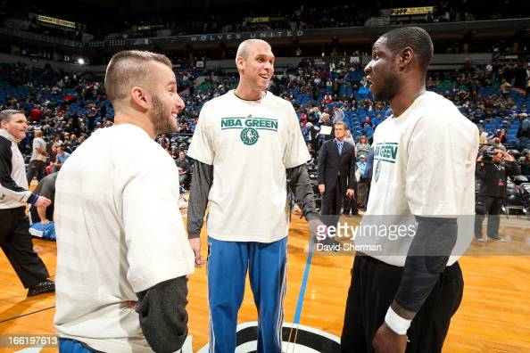 J Barea and Greg Stiemsma of the Minnesota Timberwolves greet Mickael Pietrus of the Toronto Raptors before their game played during NBA Green Week...
