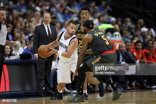 J Barea of the Dallas Mavericks dribbles the ball against Malcolm Delaney of the Atlanta Hawks in the firs half at American Airlines Center on...