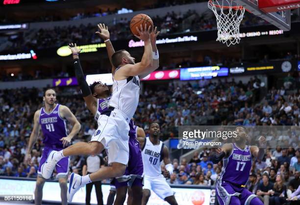 J Barea of the Dallas Mavericks drives to the basket against De'Aaron Fox of the Sacramento Kings in the second half at American Airlines Center on...
