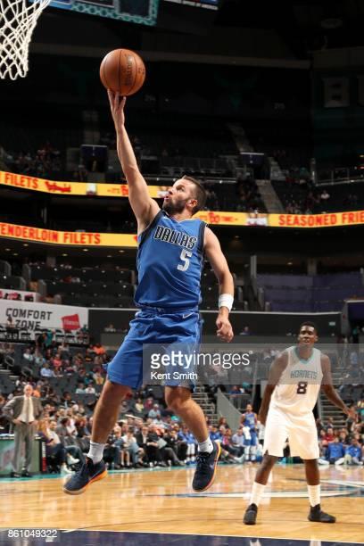 J Barea of the Dallas Mavericks goes to the basket against the Charlotte Hornets on October 13 2017 at Spectrum Center in Charlotte North Carolina...