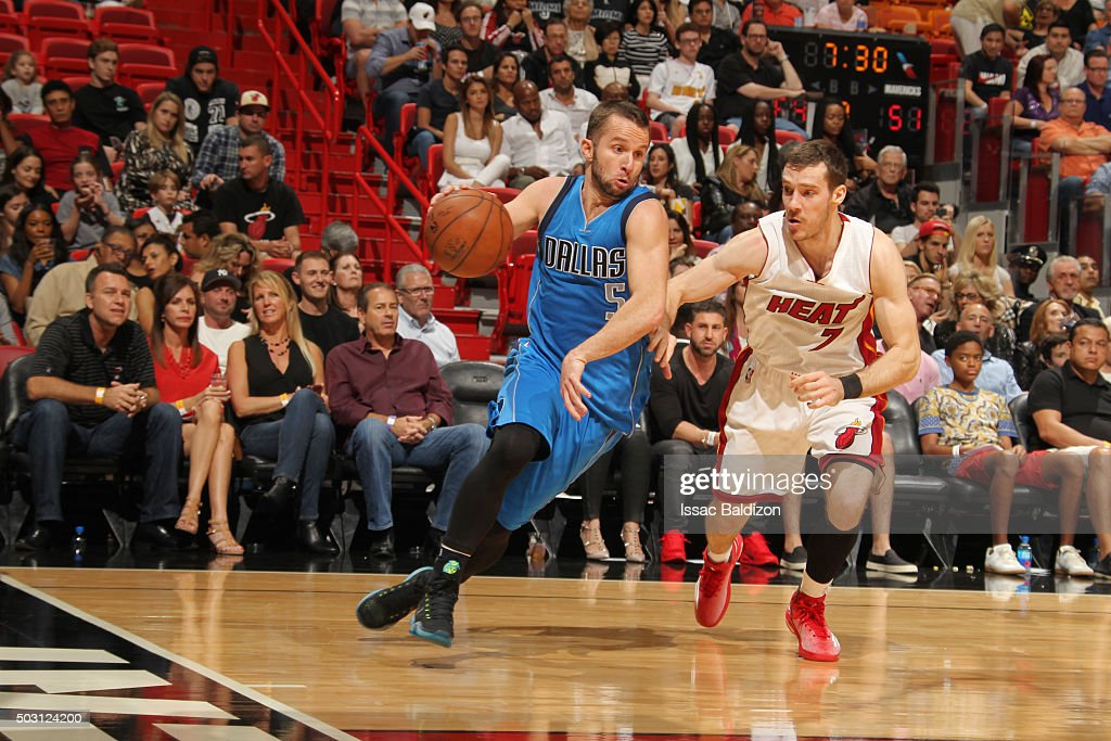 J.J. Barea #5 of the Dallas Mavericks handles the ball against Goran Dragic #7 of the Miami Heat on January 1, 2016 at American Airlines Arena in Miami, Florida.
