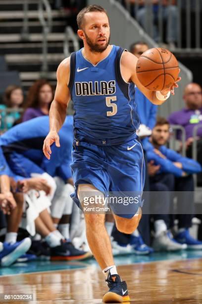 J Barea of the Dallas Mavericks handles the ball against the Charlotte Hornets on October 13 2017 at Spectrum Center in Charlotte North Carolina NOTE...